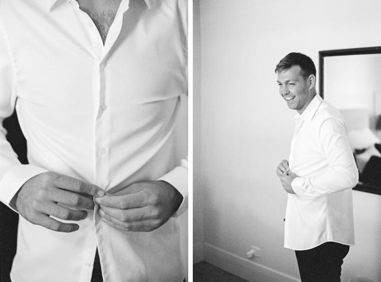 Bräutigam kleidet sich an und knöpft sich Hemd zu