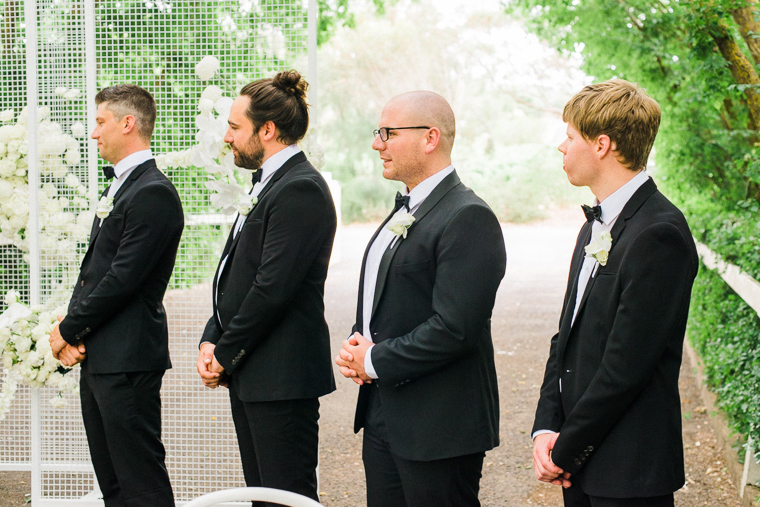 groomsmen during ceremony