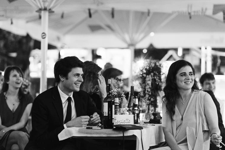 smiling wedding guests at night