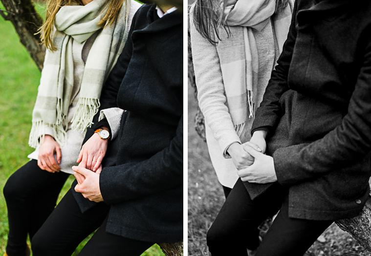 Paar hält Hände mit Verlobungsringen